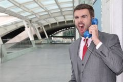 Furious man calling by old school payphone.  Royalty Free Stock Photo