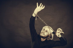 Furious man with chained hands, no freedom Royalty Free Stock Photography