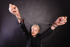 Furious man with chained hands, no freedom Royalty Free Stock Photo