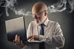 Furious man. Dealing with a laptop Stock Photos