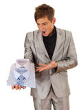 Furious man presenting shirts Stock Photo