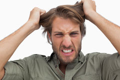 Furious man pulling his hair. On white background Royalty Free Stock Image