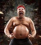 Furious man screams. Against blow Stock Photos