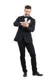 Furious man in suit crumpling contract paper with his hands Royalty Free Stock Photography