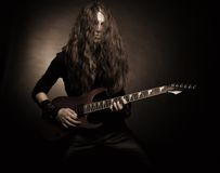 Furious metal guitarist Stock Images