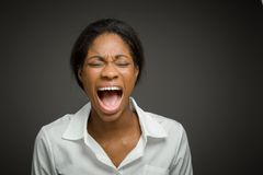 Furious model screaming. Model  on plain background in studio Stock Photography