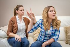 Furious mother arguing with her teenage daughter Stock Image