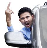 Furious person showing middle finger in car Royalty Free Stock Image