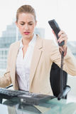 Furious pretty businesswoman hanging up the phone Stock Images