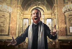 Furious priest Royalty Free Stock Images