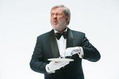 Senior waiter holding bell royalty free stock photos