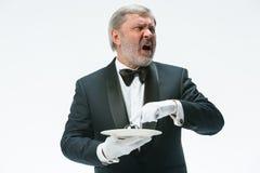 Senior waiter holding bell royalty free stock images