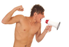 Furious shirtless young man with megaphone Royalty Free Stock Photography