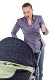 Furious shouting mother and baby buggy Stock Images