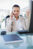 Furious sophisticated businesswoman on the phone. In bright office royalty free stock image
