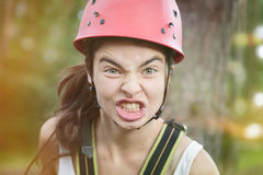 Furious teenager girl. With red climber helmet stock images