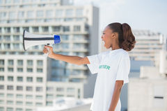 Furious volunteer woman holding and shouting in megaphone Stock Image