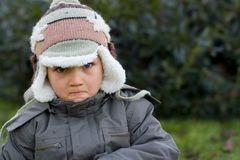 Furious Winter Boy 2. Portrait of an angry young boy in winter outerwear, taken outdoors Royalty Free Stock Photo
