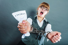 Furious woman with chained hands and contract Stock Photos