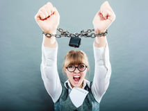 Furious woman with chained hands and contract Stock Photo