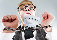 Furious woman with chained hands and contract Royalty Free Stock Photos