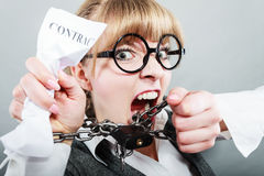 Furious woman with chained hands and contract Royalty Free Stock Photo