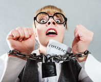 Furious woman with chained hands and contract Stock Photography