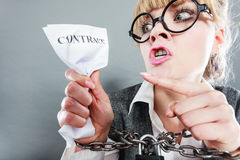 Furious woman with chained hands and contract Royalty Free Stock Photography