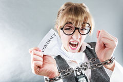 Furious woman with chained hands and contract Stock Images