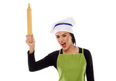 Furious woman chef with rolling pin Royalty Free Stock Photos