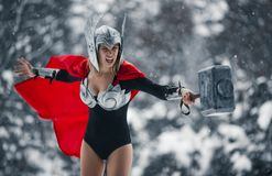 Furious woman in image of Germanic-Scandinavian God of thunder and storm. Cosplay. Young woman in image of Germanic-Scandinavian God of thunder and storm are Stock Photo