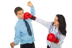 Furious woman kick business man stock image