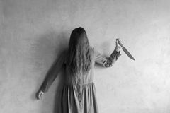 Furious woman with a knife Royalty Free Stock Image