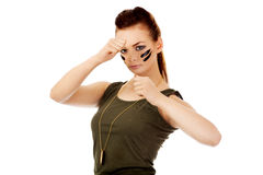Furious woman in military clothes boxing Stock Photography