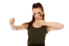 Furious woman in military clothes boxing Royalty Free Stock Photography