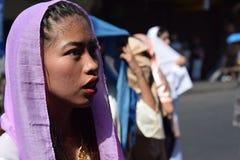 Furious woman persecuting Jesus Christ cheering, ridiculing amidst crowd, street drama, community celebrates Good Friday represent. San Pablo City, Laguna royalty free stock photo