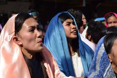 Furious woman persecuting Jesus Christ cheering, ridiculing amidst crowd, street drama, community celebrates Good Friday represent. San Pablo City, Laguna stock images