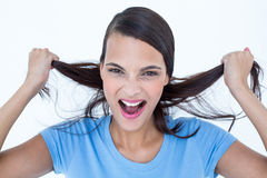 Furious woman pulling her hair Royalty Free Stock Images