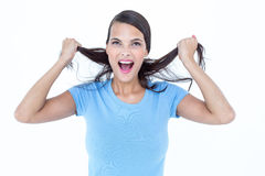 Furious woman pulling her hair Stock Image