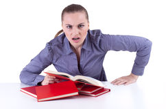 Furious woman with red  books Royalty Free Stock Image