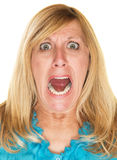 Furious Woman Screaming. Single isolated blond woman screaming over white background Stock Photography