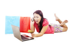Furious woman shopping online Royalty Free Stock Images