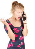 Furious woman speaks by a mobile phone Royalty Free Stock Images