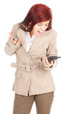 Furious woman speaks by a mobile phone. White background Royalty Free Stock Photography