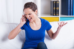 Furious woman talking on a phone Royalty Free Stock Photo