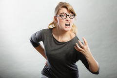 Furious woman yelling. Psychology frustration emotions feelings concept. Furious woman yelling. Nedry girl angered frustrated screaming out of wrath Stock Photography