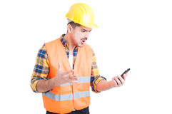 Furious young constructor yelling and showing rage Stock Photo