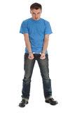 Furious young man with handcuffed hands Royalty Free Stock Photography