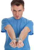 Furious young man with handcuffed hands Stock Photography