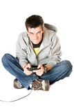 Furious young man with a joystick for game console Stock Image